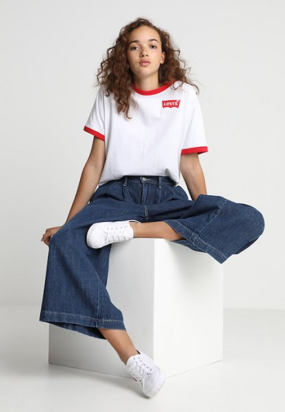 white t shirt with blue wide leg pleated jeans