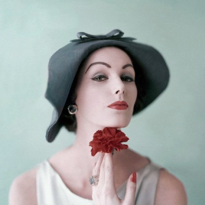 Woman Holding Red Carnation