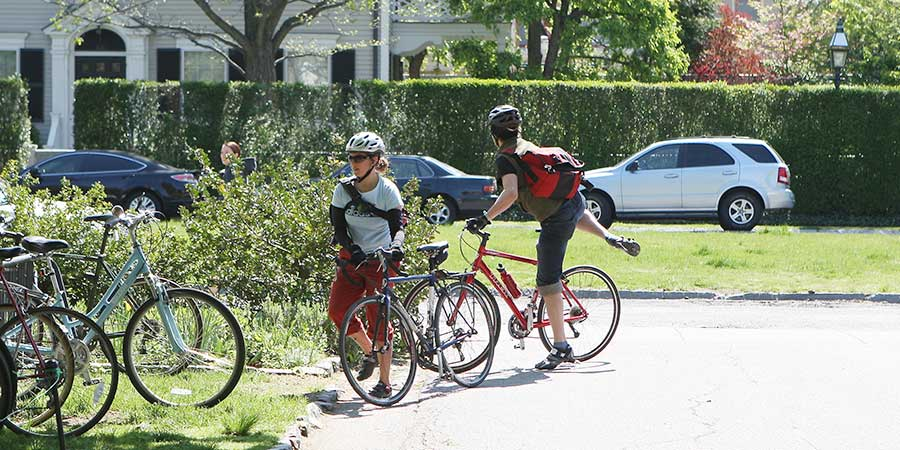 Young Adults Bicycling to Meeting