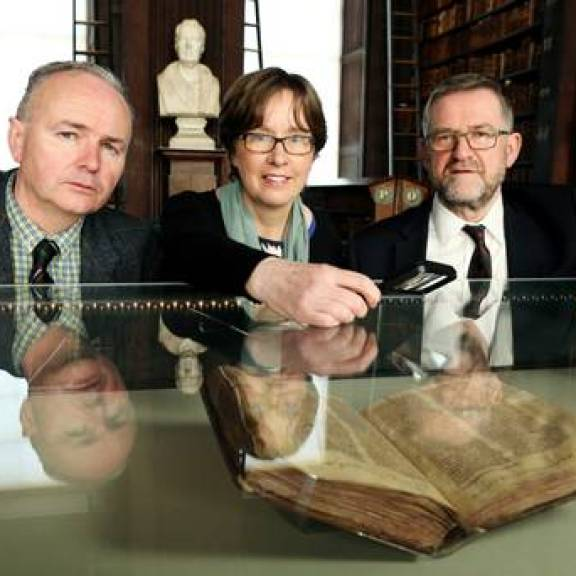 Seán Duffy, Jane Maxwell and Bernard Meehan in front of the St Mary's Abbey manuscript
