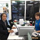 家庭での終末医療を在宅医療チームの話をする西山医院医院長の西山順博さん(左)と芦田淑恵