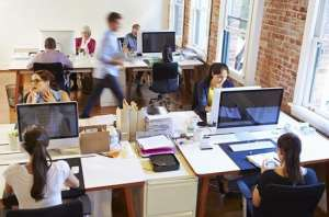 resources featured 2 - Wide Angle View Of Busy Design Office With Workers At Desks