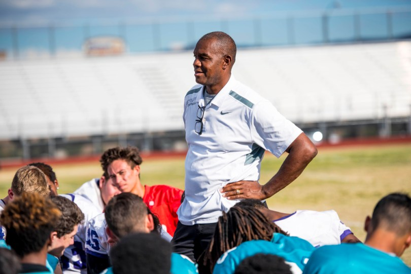 Sep 28, 2016 -- Las Vegas, NV, U.S.A -- Randall Cunningham speaks to his team during football practice at Silverado High School. Feature on Randall Cunningham and Vernon Fox who are both former NFL players, current high school coaches and ordained ministers and African-Americans. That puts them at the intersection of what NFL players are doing during the National Anthem, the trickle-down effect at high schools, the struggles of young people in urban areas and faith and race. -- Photo by Joshua Dahl/USA TODAY Sports Images, Gannett ORG XMIT: US 135535 Cunningham Fox 9/26/2016 [Via MerlinFTP Drop]