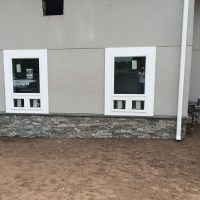 Stone Foundation & Stucco Exterior Walls