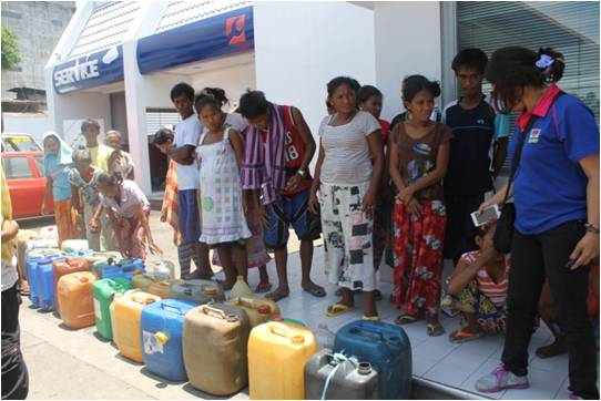 IDPs lining up for gasoline distribution facilitated by DSWD RO 9 Operations Unit staff.