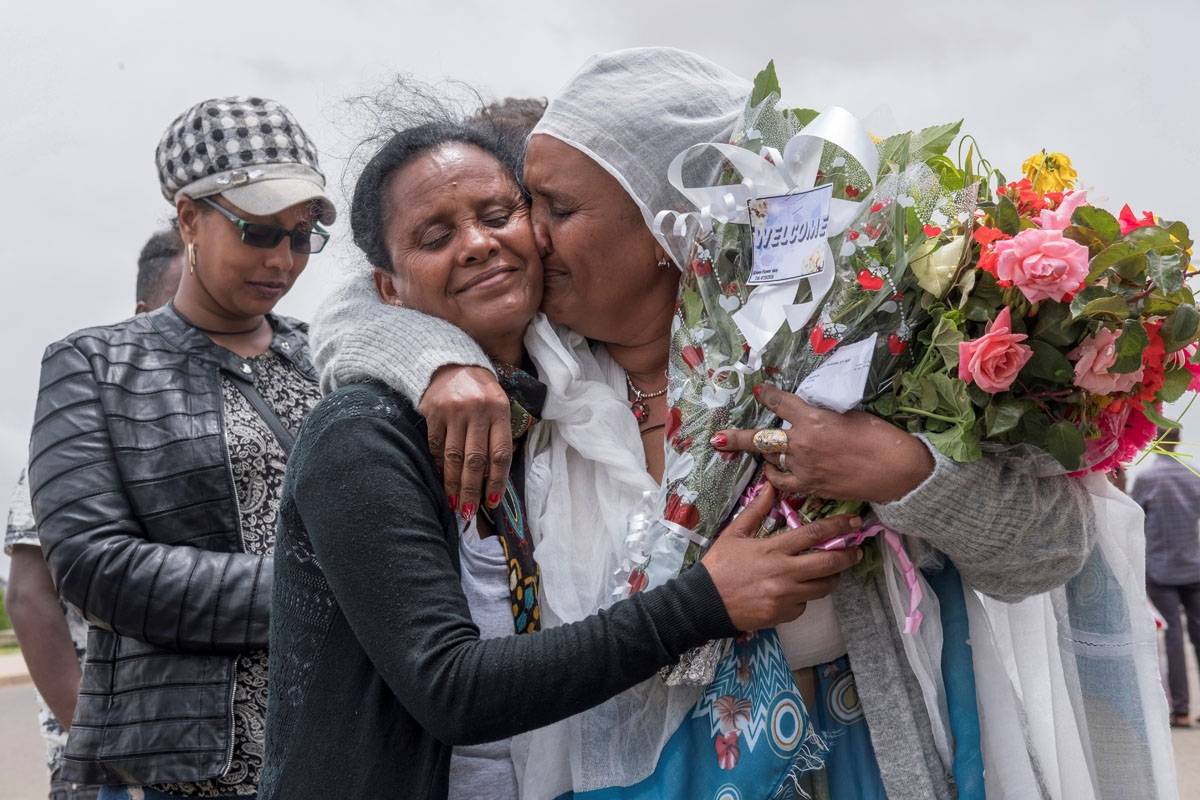 Fana Tesfatsion (R) hugs her sister Alem as the siblings see each other for the first time in five years at Asmara airport on July 21, 2018. since five years at Asmara International airport on July 21, 2018.