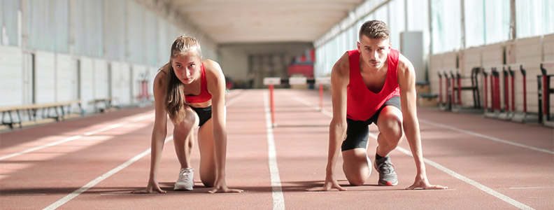 A woman and a man prepare to race each other