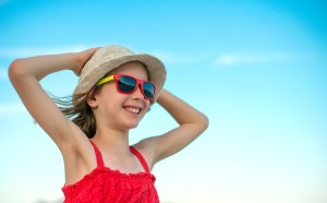 Summer vacation concept. Smiling girl in sunglasses.