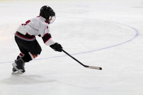 Child playing minor hockey