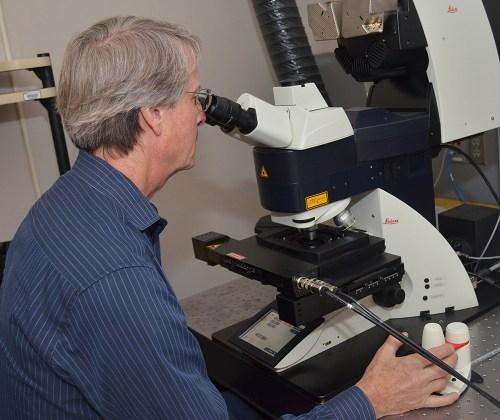 man at microscope