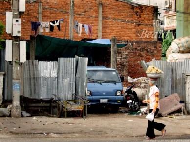 """""""Boy's Story-Woman Walking"""" by Rachel Cancino-Neill taken in Phnom Penh, Cambodia: 2009"""