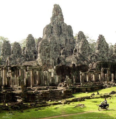 """Riding Past Angkor"""