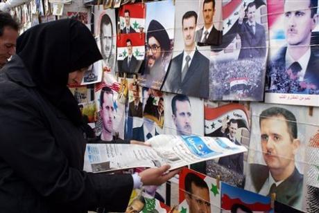 Immagini del presidente Assad nelle strade di Damasco