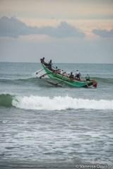 Fishing boat breaking through the waves, Sri Lanka