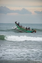 Fishing boat breaking through the waves, Sri Lanka
