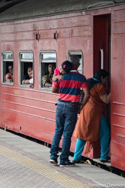 Tired girl getting on the train in Kandy, Sri Lanka