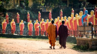 Monks walking up to a Buddhist temple.