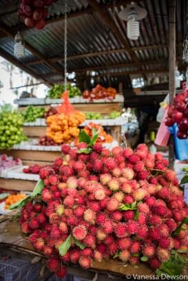 Rambutan fruit at a roadside stall.