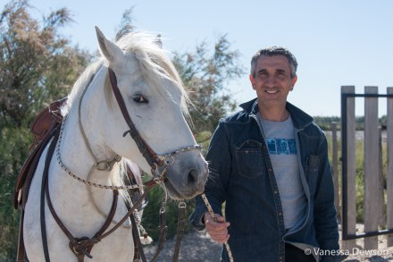 Portrait of a Guardien and his horse. Photo by: Vanessa Dewson