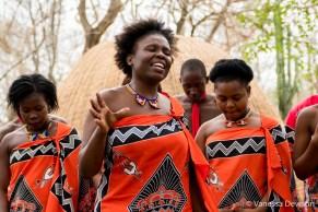 Unmarried women (in orange) sing