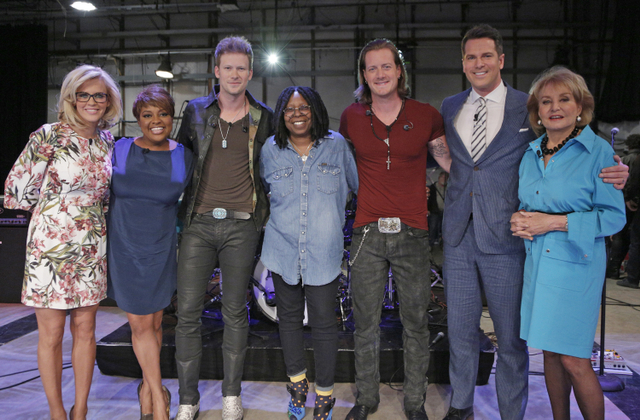Pictured L-R: The View's Jenny McCarthy, Sherri Shepherd, FGL's Brian Kelley, The View's Whoopi Goldberg, FGL's Tyler Hubbard, guest host MSNBC's Thomas Roberts and The View's Barbara Walters Photo Credit: Heidi Gutman/ABC