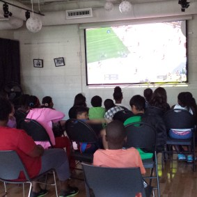Campers watching the Pan Am games during their lunch