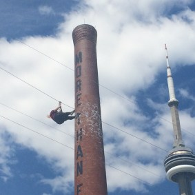 FOY Staff, Melissa Neves, soaring through the sky on the Pan Am zip-line