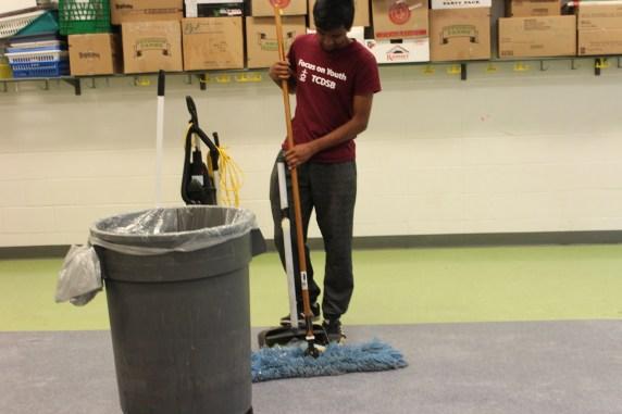 Prasath sweeping the floor.