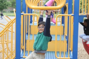 Campers monkeying around on the jungle gym