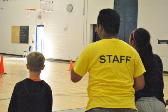 Staff and campers cheering for their teammates.
