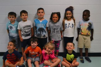 A group photo of the youngest group of campers.