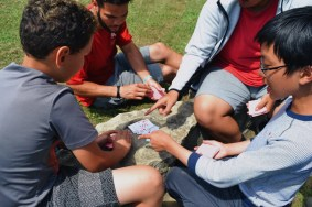 Campers and staff playing a quick game of Slap Jack.