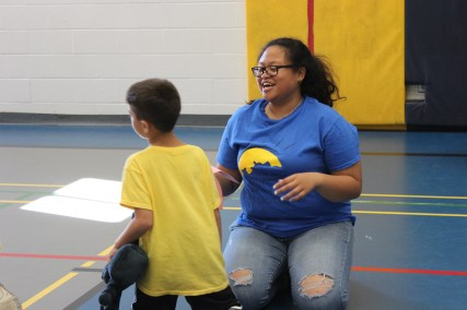 Counselor and camper team up in a game of Octopus.