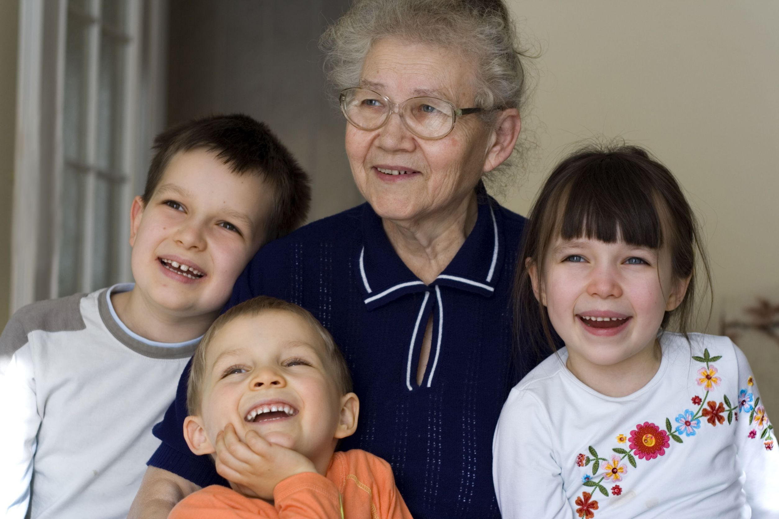 Grandmother with grandchildren laughing