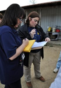 McLain, Miss., Feb. 22, 2013 -- FEMA Preliminary Disaster Assessment (PDA) Representative Karrie Beardall and Mississippi Emergency Management Agency District 1 Area Coordinator Jennifer Cobb-Willis write down information provided to them by local residents. PDA teams verify the damages with visits to the damaged homes. Greene County has requested a FEMA disaster declaration due to the damages from the flash floods which accompanied the tornado event February 10th. Photo by Marilee Caliendo/FEMA (National Archives ID: 24475833)
