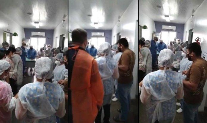 Profissionais da saúde oram em hospital durante colapso da pandemia em Manaus. (Foto: Reprodução/G1)
