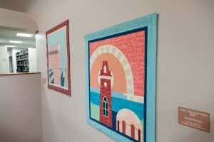Photograph of quilts hanging on wall