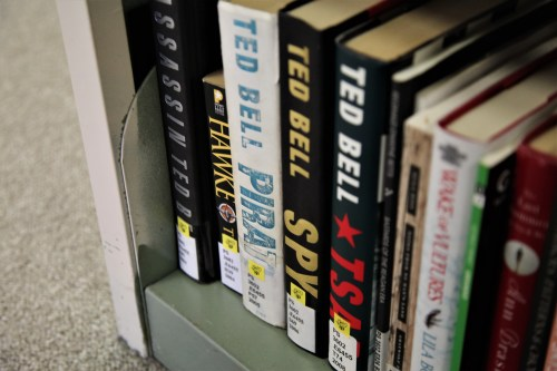 Yellow Jacket Stickers on books in the stacks.