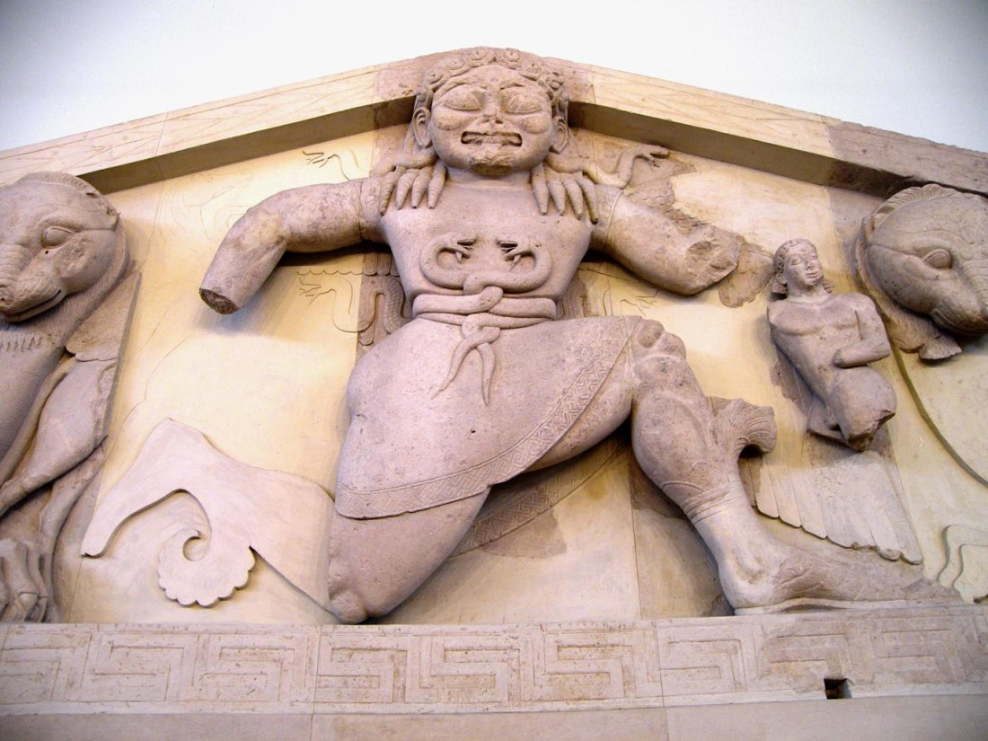 An archaic Gorgon (around 580 BC), as depicted on a pediment from the temple of Artemis in Corfu, on display at the Archaeological Museum of Corfu. (https://commons.wikimedia.org/w/index.php?curid=16700263)