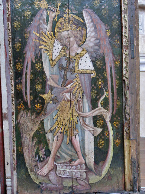 The rood screen in St Helen's Church, Ranworth, depicts the archangel St Michael slaying the dragon. Michael was often depicted in armour or with a sword and shield, to indicate his martial responsibilities as leader of the heavenly host. Evelyn Simak, CC BY-SA 2.0, https://commons.wikimedia.org/w/index.php?curid=13394983