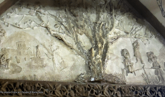 The plaster frieze at Y Sospan showing a tree with hanged people swinging from it.