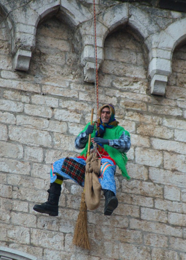 An Italian firefighter dressed up as the Befana descends from Gubbio's medieval buildings. By Beatrice - Own work, CC BY-SA 3.0, https://commons.wikimedia.org/w/index.php?curid=17930291
