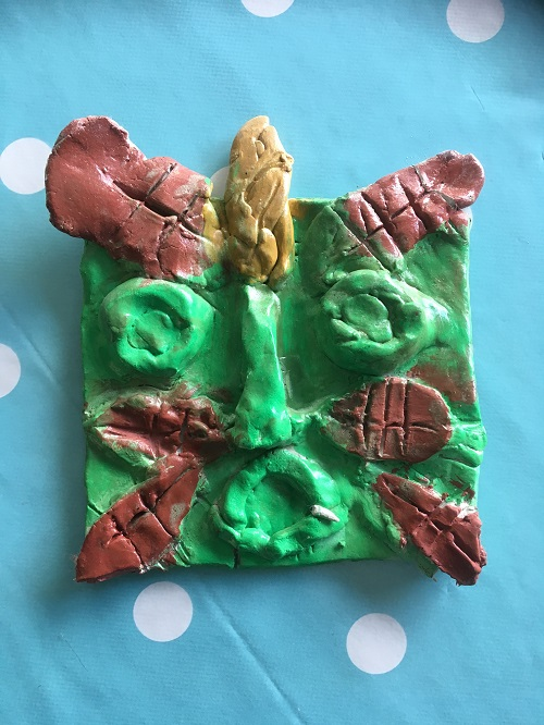 Green Man clay tile inspired by cathedral carvings © Kate Boughton