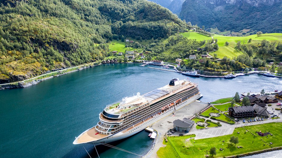 Big passenger ship in a bay. Picturesque, beautiful bay with a cruise ship.