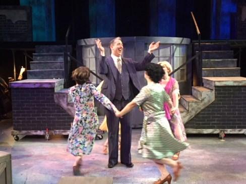 Boni (William Roberts) and the ladies of the cabaret