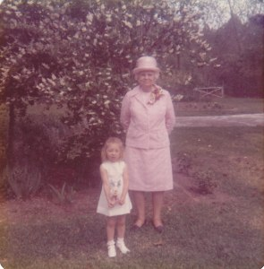 Granny, me, and a flowering bush