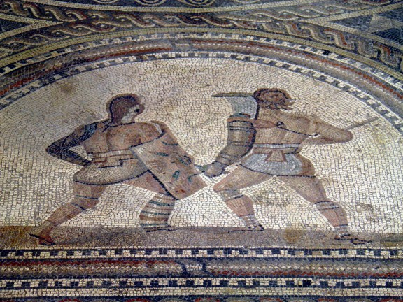Detail of Gladiator mosaic, a Secutor (left) fighting a Retiarus (right), Römerhalle, Bad Kreuznach Carole Raddato