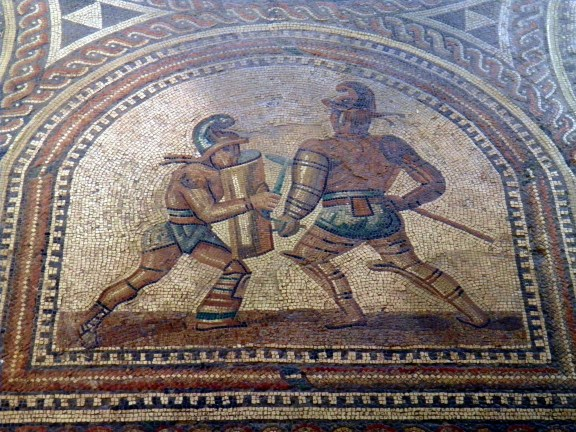 Detail of the Gladiator mosaic floor, a Hoplomachus fighting a  Thraex, Römerhalle, Bad Kreuznach © Carole Raddato