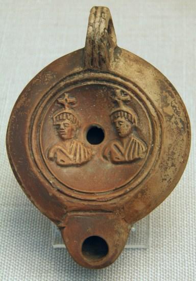 Castor and Pollux (Dioscuri), terracotta Roman oil lamp 1st cent. AD