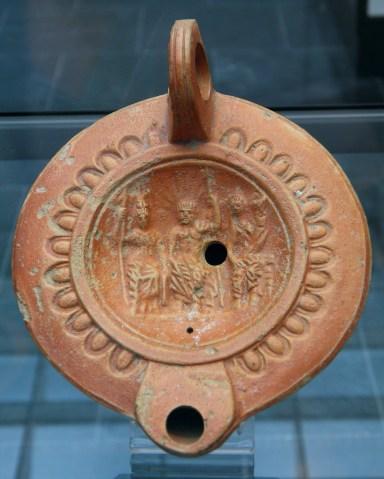 The Capitoline Triad (Jupiter, Juno, Minerva), Roman oil lamp terracotta, 1st century AD